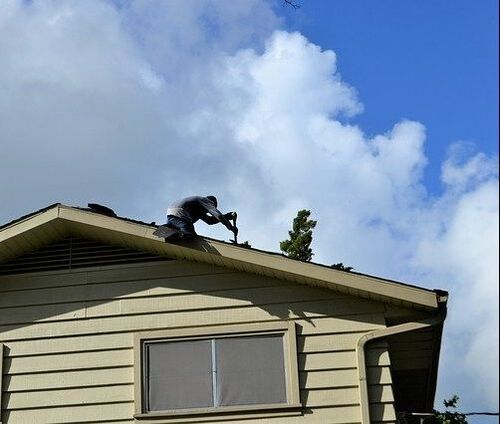 A man fixing a rooftop in Thousand Oaks