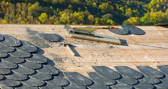 Shingles being hammered onto a roof