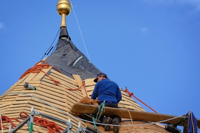 A roofing contractor replacing a roof